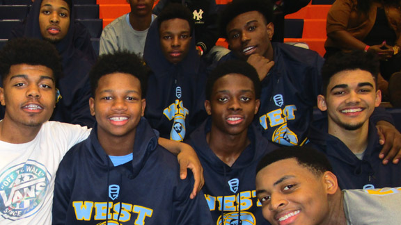 Putnam City West players are all smiles after the Patriots' 80-60 Platinum Division quarterfinal victory over Prestonwood Christian Academy (Plano, Texas) pushed PCW's record to 6-0.