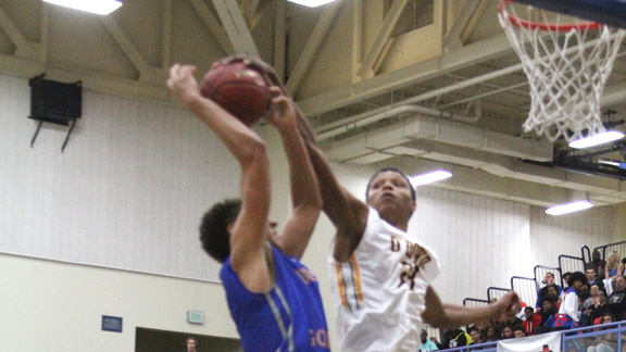 First team Grassroots Hoops All-American Ivan Rabb (right) of Bishop O'Dowd (Oakland, Calif.) blocks a shot by second teamer Chase Jeter of Bishop Gorman (Las Vegas) in the first game of the 2014-15 season. Photo: Willie Eashman/Cal-Hi Sports